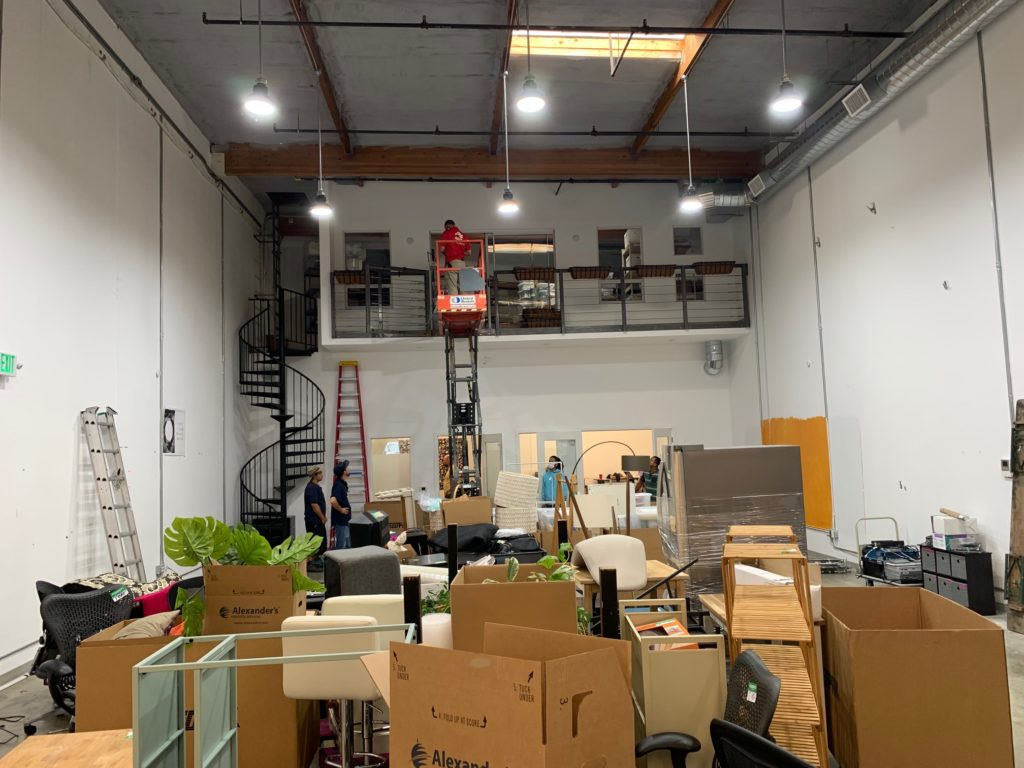 Creativebug office space filled with moving boxes